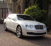 Bentley Flying Spur Hire in Red Cloak